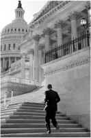 Sen. Barack Obama runs up the steps of the U.S. Capitol.