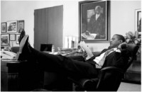 Relaxed while reading in his office.