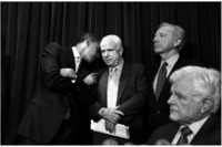 Whispering to McCain at a press conference.