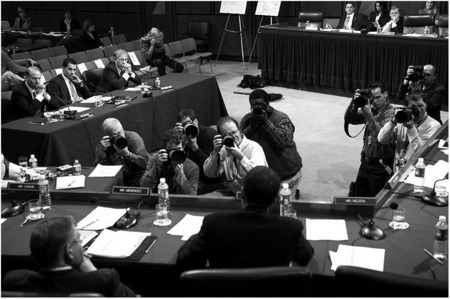 Photographers zoom in on Obama and not the witnesses at a Senate hearing.